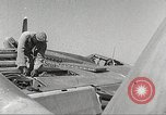 Image of Ground Crewmen of 332nd Fighter Group maintain P-51s Termoli Italy, 1944, second 60 stock footage video 65675062615