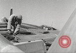 Image of Ground Crewmen of 332nd Fighter Group maintain P-51s Termoli Italy, 1944, second 61 stock footage video 65675062615