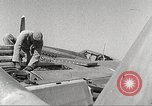 Image of Ground Crewmen of 332nd Fighter Group maintain P-51s Termoli Italy, 1944, second 62 stock footage video 65675062615