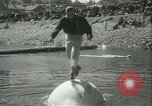 Image of log-rolling championship Port Townsend Washington USA, 1937, second 28 stock footage video 65675062689