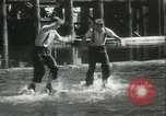 Image of log-rolling championship Port Townsend Washington USA, 1937, second 44 stock footage video 65675062689