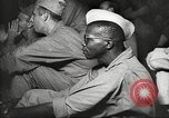 Image of U.S. Service personnel watch movies during World War II Pacific Theater, 1943, second 20 stock footage video 65675062810