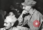 Image of U.S. Service personnel watch movies during World War II Pacific Theater, 1943, second 30 stock footage video 65675062810
