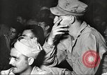 Image of U.S. Service personnel watch movies during World War II Pacific Theater, 1943, second 31 stock footage video 65675062810