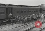 Image of US Army soldiers board trains for war United States USA, 1944, second 7 stock footage video 65675062823