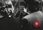 Image of telephone operator United States USA, 1944, second 5 stock footage video 65675062826