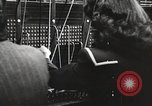 Image of telephone operator United States USA, 1944, second 8 stock footage video 65675062826