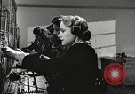 Image of telephone operator United States USA, 1944, second 16 stock footage video 65675062826
