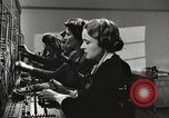 Image of telephone operator United States USA, 1944, second 17 stock footage video 65675062826