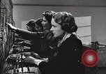 Image of telephone operator United States USA, 1944, second 18 stock footage video 65675062826