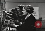 Image of telephone operator United States USA, 1944, second 19 stock footage video 65675062826
