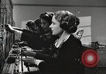 Image of telephone operator United States USA, 1944, second 20 stock footage video 65675062826