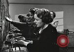 Image of telephone operator United States USA, 1944, second 21 stock footage video 65675062826