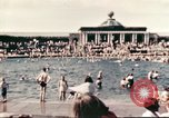 Image of Outdoor swimming pool in England England United Kingdom, 1943, second 2 stock footage video 65675062853