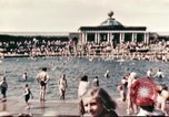 Image of Outdoor swimming pool in England England United Kingdom, 1943, second 4 stock footage video 65675062853