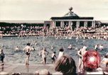 Image of Outdoor swimming pool in England England United Kingdom, 1943, second 5 stock footage video 65675062853