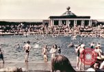 Image of Outdoor swimming pool in England England United Kingdom, 1943, second 7 stock footage video 65675062853