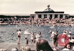 Image of Outdoor swimming pool in England England United Kingdom, 1943, second 8 stock footage video 65675062853