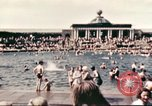 Image of Outdoor swimming pool in England England United Kingdom, 1943, second 9 stock footage video 65675062853