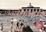 Image of Outdoor swimming pool in England England United Kingdom, 1943, second 10 stock footage video 65675062853