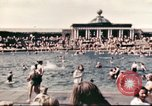 Image of Outdoor swimming pool in England England United Kingdom, 1943, second 11 stock footage video 65675062853