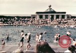 Image of Outdoor swimming pool in England England United Kingdom, 1943, second 14 stock footage video 65675062853