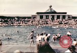 Image of Outdoor swimming pool in England England United Kingdom, 1943, second 15 stock footage video 65675062853