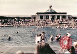 Image of Outdoor swimming pool in England England United Kingdom, 1943, second 16 stock footage video 65675062853
