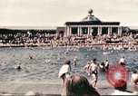 Image of Outdoor swimming pool in England England United Kingdom, 1943, second 17 stock footage video 65675062853