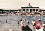 Image of Outdoor swimming pool in England England United Kingdom, 1943, second 18 stock footage video 65675062853