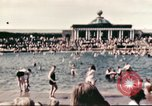 Image of Outdoor swimming pool in England England United Kingdom, 1943, second 25 stock footage video 65675062853