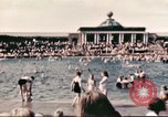 Image of Outdoor swimming pool in England England United Kingdom, 1943, second 26 stock footage video 65675062853