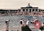 Image of Outdoor swimming pool in England England United Kingdom, 1943, second 27 stock footage video 65675062853
