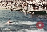 Image of Outdoor swimming pool in England England United Kingdom, 1943, second 38 stock footage video 65675062853