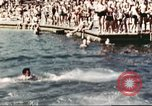 Image of Outdoor swimming pool in England England United Kingdom, 1943, second 39 stock footage video 65675062853