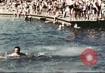 Image of Outdoor swimming pool in England England United Kingdom, 1943, second 41 stock footage video 65675062853