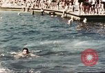 Image of Outdoor swimming pool in England England United Kingdom, 1943, second 42 stock footage video 65675062853