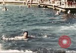 Image of Outdoor swimming pool in England England United Kingdom, 1943, second 43 stock footage video 65675062853