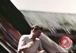 Image of Outdoor swimming pool in England England United Kingdom, 1943, second 52 stock footage video 65675062853