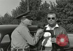 Image of taxicab driver Berlin Germany, 1959, second 24 stock footage video 65675062920