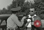 Image of taxicab driver Berlin Germany, 1959, second 27 stock footage video 65675062920