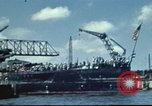 Image of USS Nevada leaving drydock after repairs Pearl Harbor Hawaii USA, 1942, second 2 stock footage video 65675062939