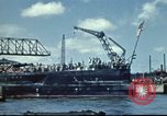 Image of USS Nevada leaving drydock after repairs Pearl Harbor Hawaii USA, 1942, second 3 stock footage video 65675062939