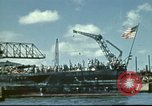 Image of USS Nevada leaving drydock after repairs Pearl Harbor Hawaii USA, 1942, second 11 stock footage video 65675062939