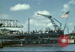 Image of USS Nevada leaving drydock after repairs Pearl Harbor Hawaii USA, 1942, second 12 stock footage video 65675062939
