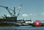 Image of USS Nevada leaving drydock after repairs Pearl Harbor Hawaii USA, 1942, second 13 stock footage video 65675062939
