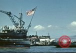Image of USS Nevada leaving drydock after repairs Pearl Harbor Hawaii USA, 1942, second 16 stock footage video 65675062939