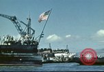Image of USS Nevada leaving drydock after repairs Pearl Harbor Hawaii USA, 1942, second 17 stock footage video 65675062939