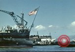 Image of USS Nevada leaving drydock after repairs Pearl Harbor Hawaii USA, 1942, second 18 stock footage video 65675062939