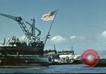 Image of USS Nevada leaving drydock after repairs Pearl Harbor Hawaii USA, 1942, second 19 stock footage video 65675062939